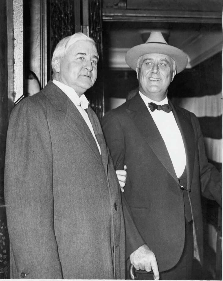 "Jesse H. Jones with Franklin D. Roosevelt, date unknown. In 1933, FDR appointed Jones head of the Reconstruction Finance Corporation in charge of bailing out the banks that had failed in the Depression. Jones was so powerful, FDR called him ""Jesus H. Jones."" After Jones' death, the Houston Endowment, established with his money, built the modern performing-arts space Jones had wanted for Houston. Photo: Unknown / Houston Chronicle"