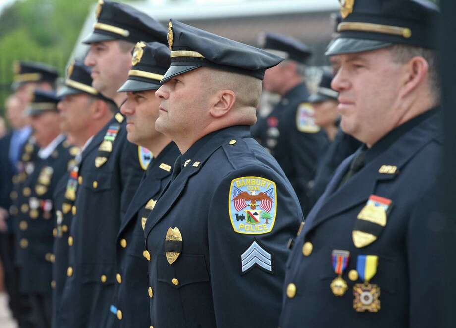 Sargent Marc Scocozza stands at attention during the Danbury Police Department's   Memorial Service & 32nd Annual Awards Ceremony on Thursday morning, May 19, 2016, at the Danbury Police Department, Danbury, Conn. Photo: H John Voorhees III, Hearst Connecticut Media / The News-Times