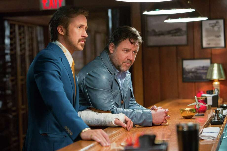"""This image released by Warner Bros. Entertainment shows Ryan Gosling, left, and Russell Crowe in a scene from """"The Nice Guys."""" (Daniel McFadden/Warner Bros. Entertainment via AP) ORG XMIT: NYET941 Photo: Daniel McFadden / Warner Bros. Entertainment"""