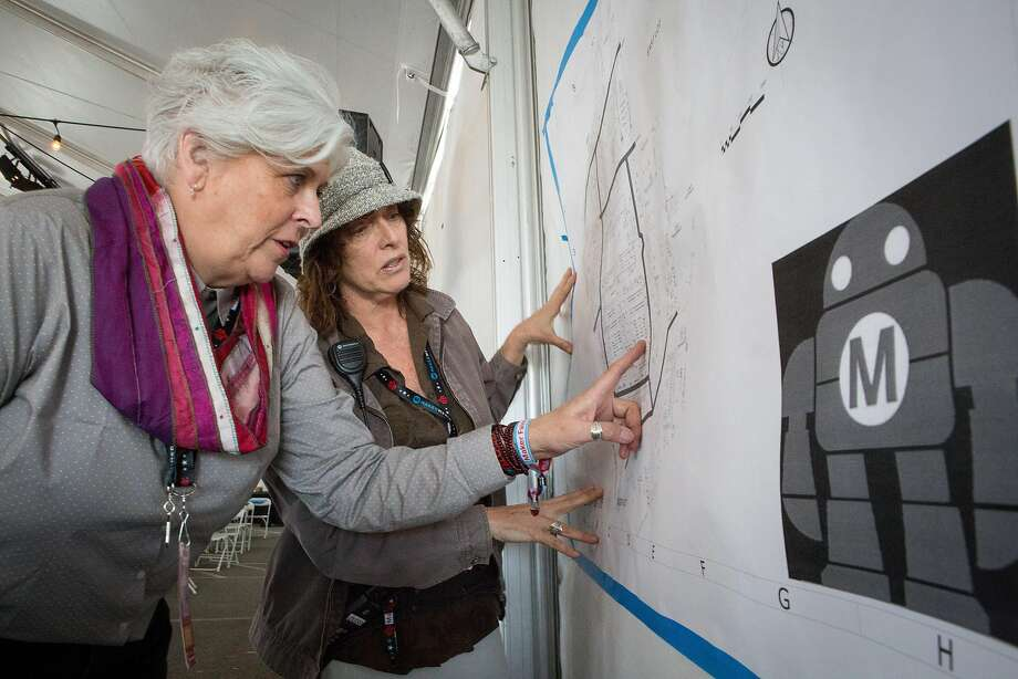 Left: Maker Faire co-founder Sherry Huss (left) and producer Louise Glasgow go over the grounds map at the San Mateo Event Center, where exhibits will be set up for the weekend event. Photo: Amy Osborne, Special To The Chronicle
