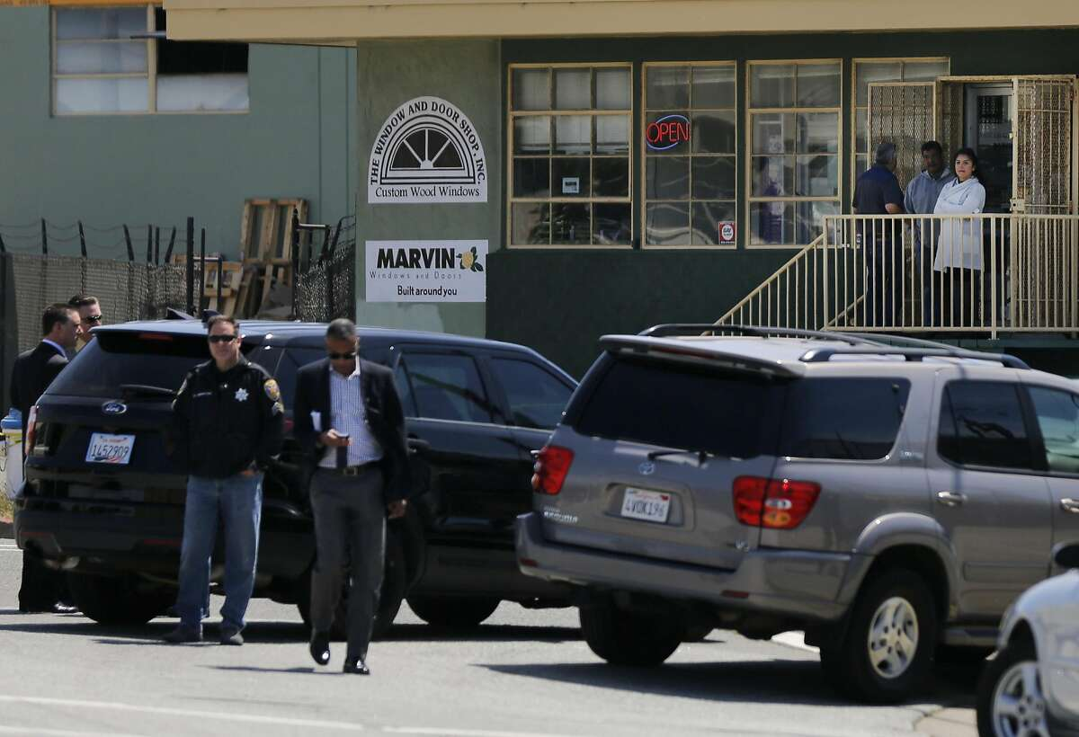 People survey the area behind the police line at Shafter Ave and Industrial Street near the scene of an officer involved shooting on Elmira Street that ended in the death of the woman who was shot May 19, 2016 in San Francisco, Calif. Police officers began pursuing a car that came up as stolen in their system and after the woman crashed the car into a parked vehicle, she was shot once while officers tried to remove her from the car and she died from the gunshot wound.