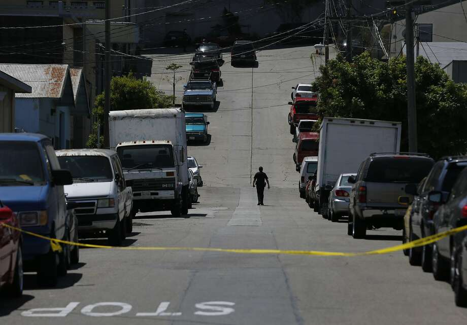 A police officer walks down Elmira Street toward the scene of a fatal officer-involved shooting. Photo: Leah Millis, The Chronicle