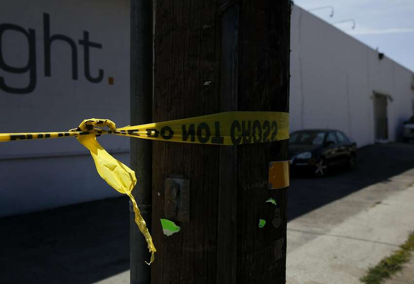 Police tape is seen tied to a pole on Charter Oak Ave near the scene of an officer involved shooting on Elmira Street that ended in the death of the woman who was shot May 19, 2016 in San Francisco, Calif. Police officers began pursuing a car that came up as stolen in their system and after the woman crashed the car into a parked vehicle, she was shot once while officers tried to remove her from the car and she died from the gunshot wound.