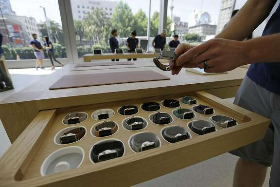 An employee pulls out an Apple Watch during a preview of the new Apple Union Square store Thursday, May 19, 2016, in San Francisco. (AP Photo/Eric Risberg)