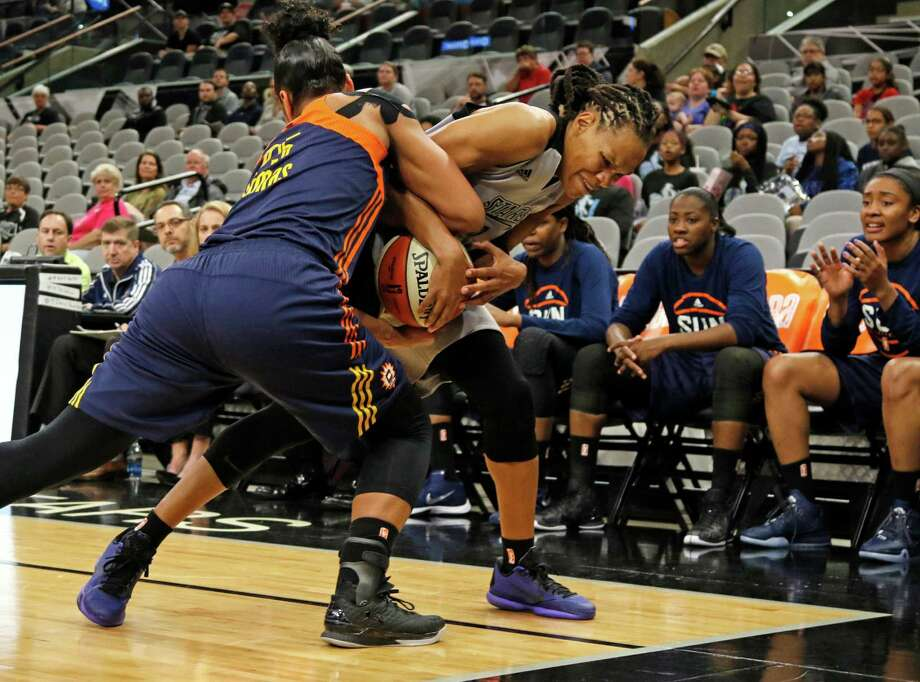 San Antonio Stars Monique Currie tries to wrestle away the ball from Connecticut Alyssa Thomas (left) in first half action at AT&T Center on May 18, 2016. Photo: Ron Cortes /For The Express-News