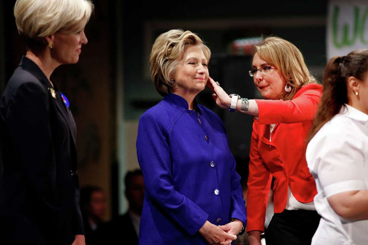 Hillary Clinton stands between Ellen Richards (left), daughter of former Texas Gov. Ann Richards, and former U.S. Rep. Gabrielle Giffords of Arizona at a rally in New York last month.