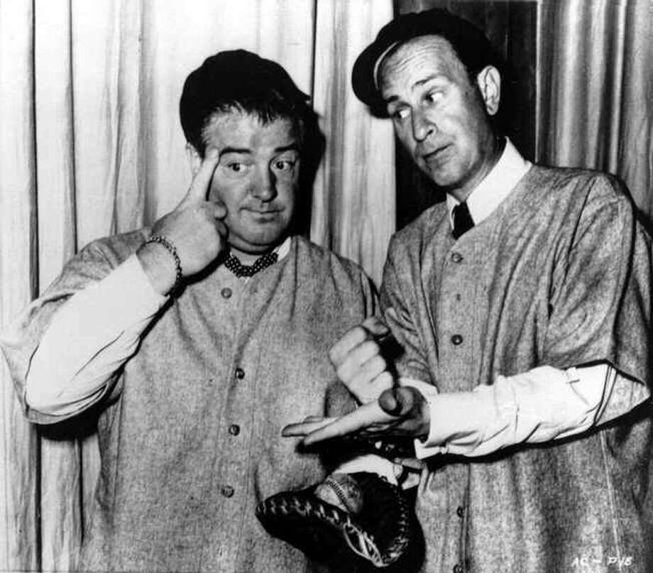 Bud Abbott, right, and his partner Lou Costello, do their famous baseball sketch in an undated photo. A reader says Photo: Anonymous /ASSOCIATED PRESS / AP