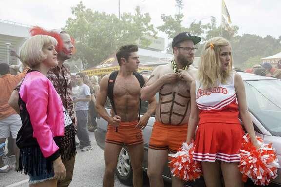 "Carla Gallo, from left, Ike Barinholtz, Zac Efron, Seth Rogen and Rose Byrne star in ""Neighbors 2: Sorority Rising."""
