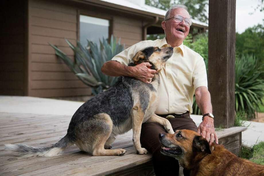 Jack Terrell, 85, shares a moment with Bandit, left, and Maggie on the porch of his son's home in Cypress. Thanks to a DNA match on a Houston-based family-tree website, Terrell is now in touch with a large extended family. Photo: Marie D. De Jesus, Staff / © 2016 Houston Chronicle