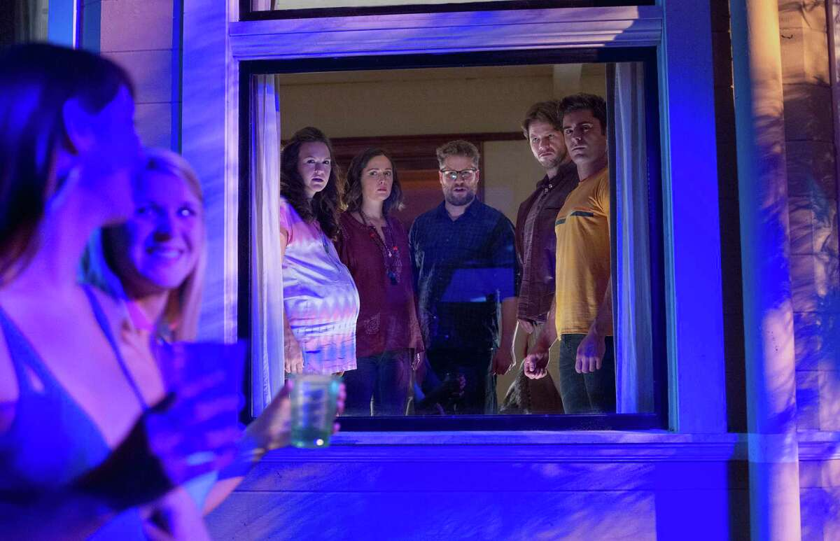 "Carla Gallo, back, from left, Rose Byrne, Seth Rogen, Ike Barinholtz and Zac Efron star in ""Neighbors 2: Sorority Rising."""