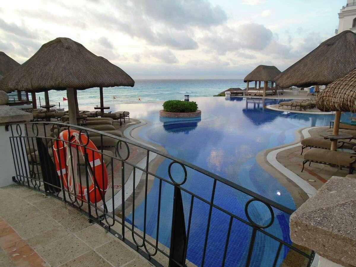 Fanciful bridges cross the beachfront infinity pool at the JW Marriott Cancun Resort.