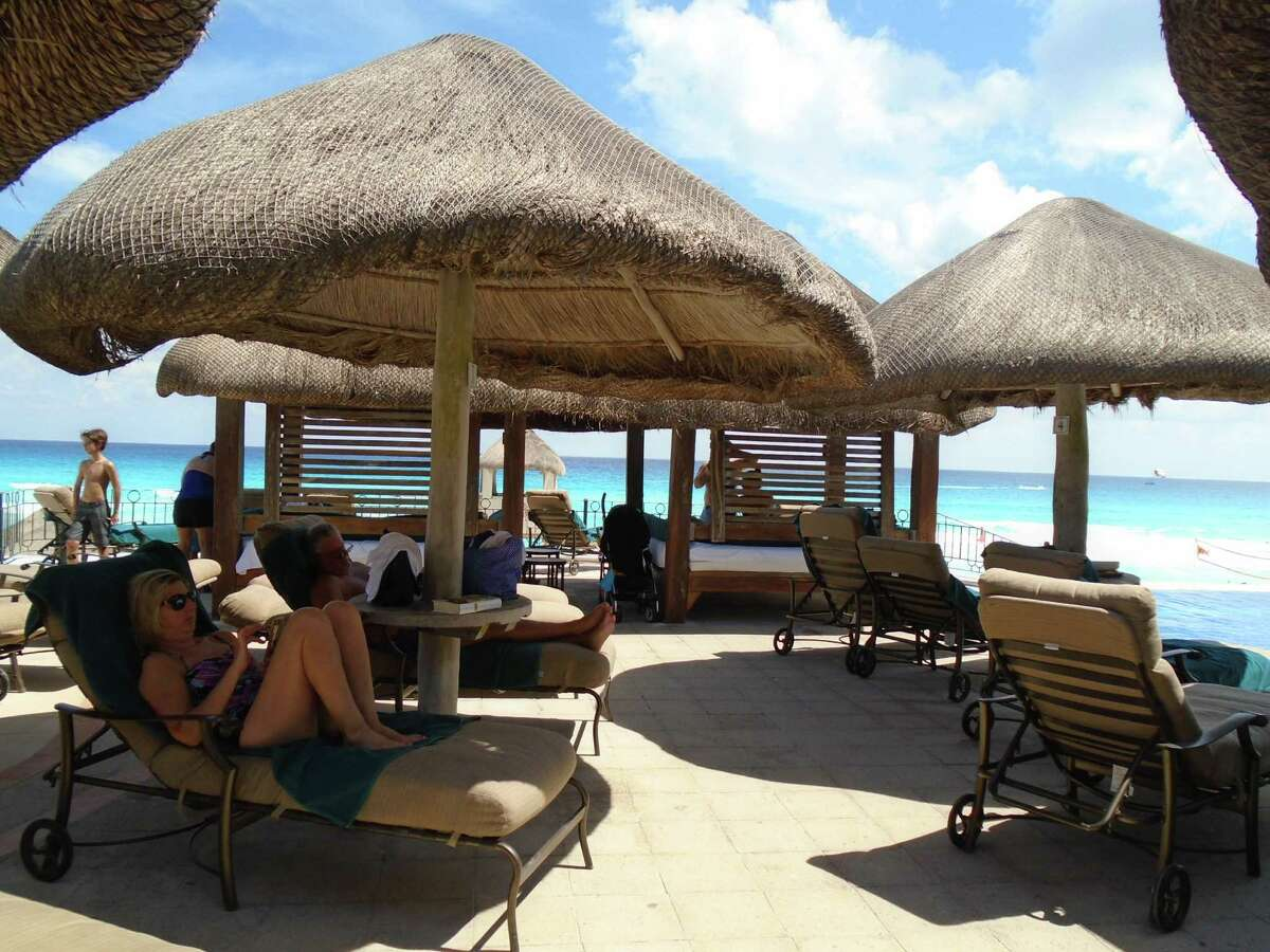 Relax in shaded spots at seaside resorts like the JW Marriott Cancun.