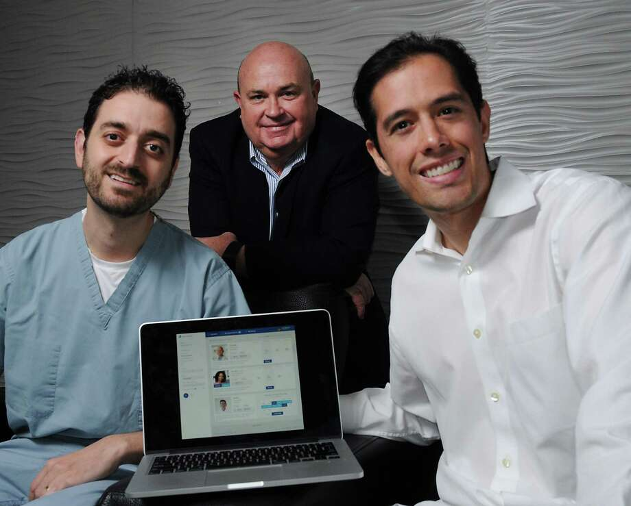 Dr. Reza Sanjar, left, one of the founders of clouddentistry.com, had the help of Glenn Barnett, center, and Trey Tepichin. Tepichin says the goal is to let dentists pick and choose from specialists online and let both sides rate each other afterward.   Photo: Dave Rossman, Freelance / Dave Rossman