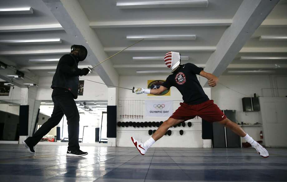 Fencing coach Greg Massialas (left) and son Alexander train at the Sunset District studio to compete in Rio de Janeiro. Photo: Michael Macor, The Chronicle