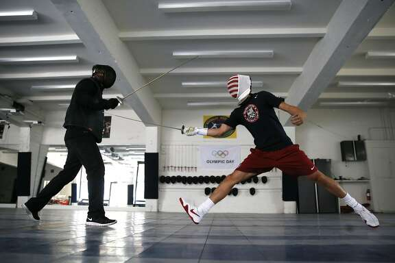 Greg Massialas,  (left) and his son Alexander during a practice session at their training facility in San Francisco , California on Thurs. May 19, 2016. Massialas started his fencing program seventeen years ago and now his son Alex is the top-rated fencer in the country.