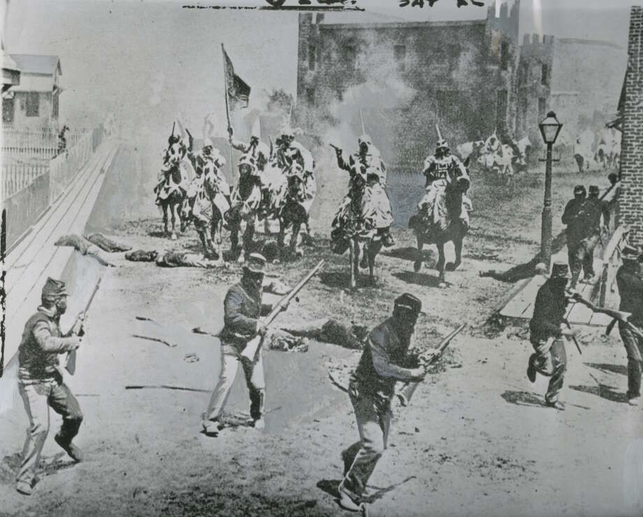 "Information provided on photo: This is one of the many big scenes in ""Birth of a Nation,"" which was a headache for its producer and director, D.W. Griffith. He hd to find horses, which were in scarce supply, for these Klansmen to ride; and he also had to round up hundreds of bedsheets for them to wear. The picture cost $110,000, an enormous figure for 1914, when it was made. Photo: Seattlepi.com Archive"
