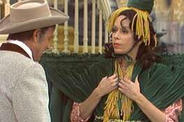 "Harvey Korman and Carol Burnett in an undated episode of ""The Caroll Burnett Show."""