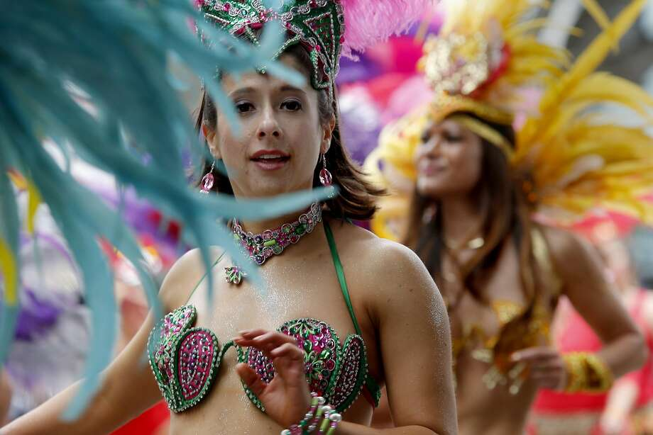 Samba performers from Muito Quente march in the Carnaval parade in San Francisco in 2015. More than 60 organizations will join the Grand Parade on Sunday, May 29. Photo: Brant Ward, The Chronicle