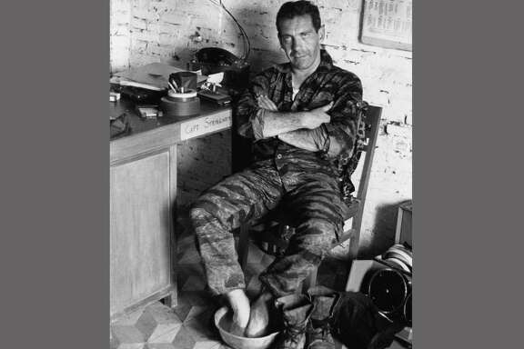 Morley Safer soaks his feet while on assignment in South Vietnam in 1965. He exposed a military atrocity in Vietnam that played an early role in changing Americans' view of the war.