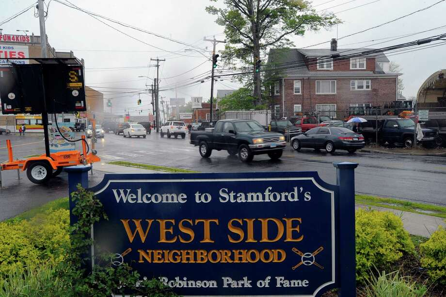 Traffic on West Main Street passes by a Welcome to Stamford's West Side Neighborhood sign, shown in a photo taken on May 13, 2016. Shootings on the West Side are on an uprise, with the latest occurring on Tuesday night, May 10 at Stillwater and Liberty Street around 9 PM. The victim, who was shot in the chest, ran to nearby Stamford Hospital, according to police reports on the incident. Photo: Matthew Brown / Hearst Connecticut Media / Stamford Advocate