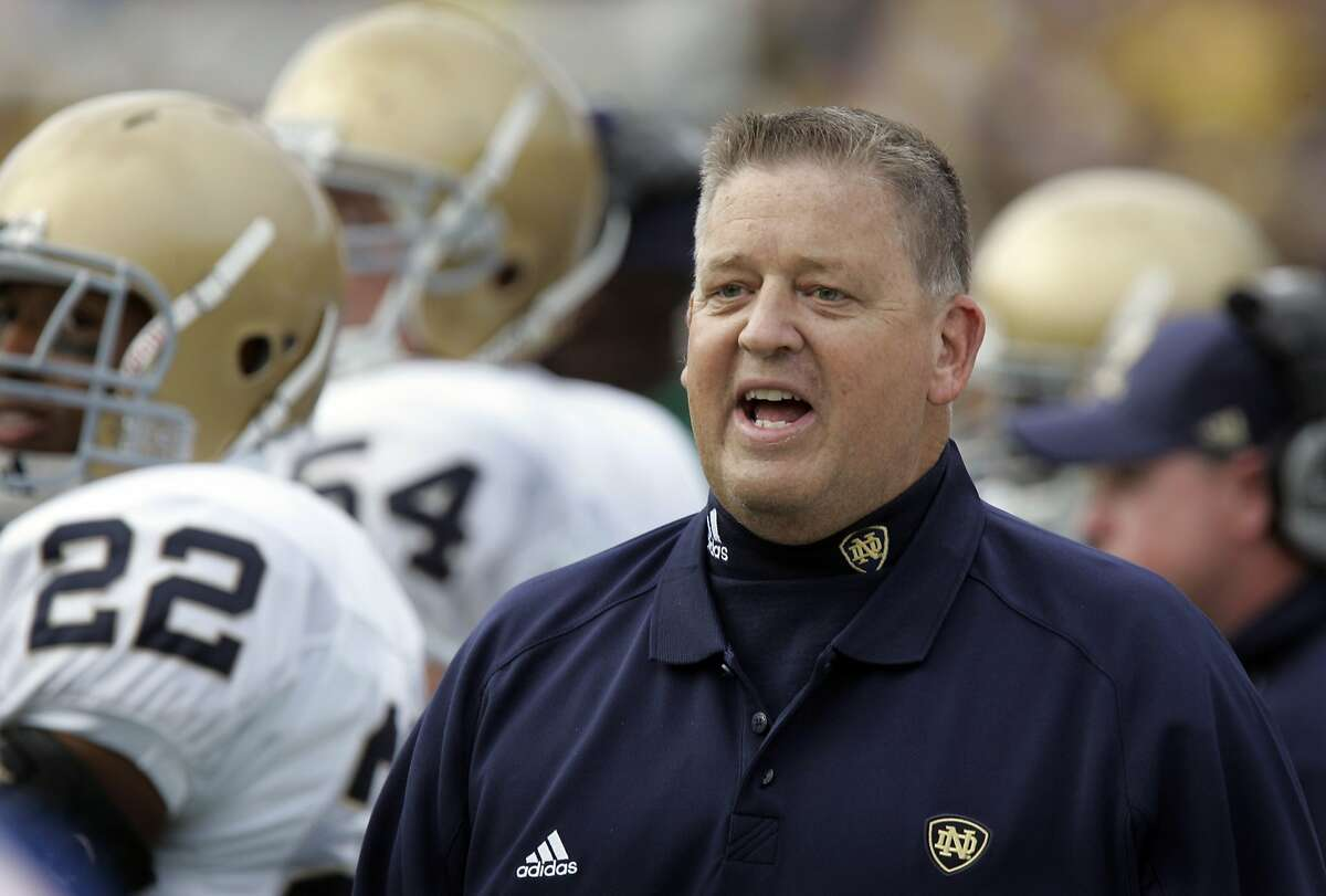 FILE - In this Sept. 15, 2007, file photo, Notre Dame coach Charlie Weis looks from the sidelines during the fourth quarter of an NCAA college football game against Michigan in Ann Arbor, Mich.,The former Notre Dame coach remained the highest-paid coach on Notre Dame's payroll last year despite being fired in 2009. The university paid Weis $2,054,744 between July 1, 2014, and June 30, 2015, according to Notre Dame's most recent IRS documents made public this week. The documents say the payments ended last December. (AP Photo/Carlos Osorio, File)