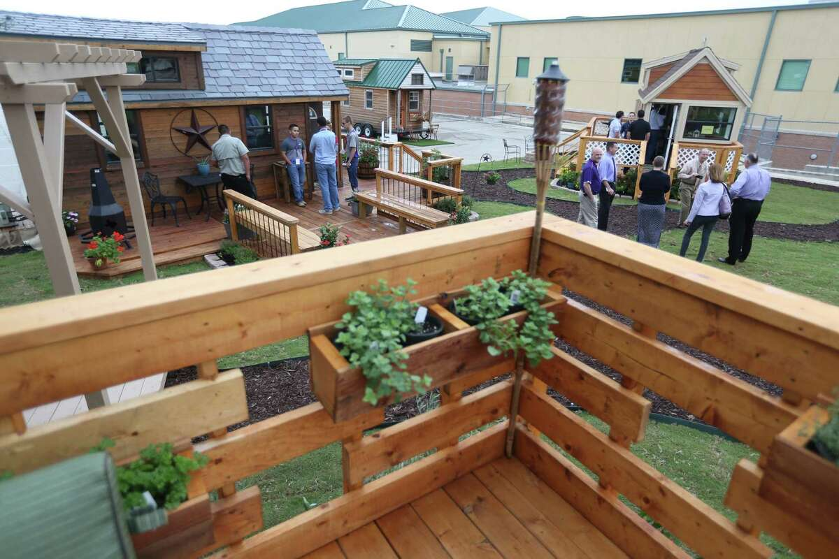 Teams of seniors at Construction Careers Academy show the tiny homes Wednesday morning, May 18, 2016 they built for the third annual Parade of Homes competition, sponsored by the Northside Independent School District. The homes are all fully-functional buildings that are 152 square feet or less.