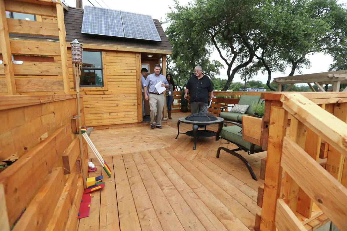 Frank Sitterle left, of Sitterle Homes, and Gilbert Sanchez of HomeWerks, leave a tiny home built by seniors at Construction Careers Academy as they judge the home Wednesday morning, May 18, 2016. The students built the home for the third annual Parade of Homes competition, sponsored by the Northside Independent School District. The four homes are all fully-functional buildings that are 152 square feet or less.