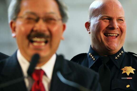 San Francisco Mayor Ed Lee left, jokes that Greg Suhr first job as San Francisco new police chief will be to find his birth certificate. Lee appointed Greg Suhr in front of an overflow crowd as the new chief of police for SFPD at San Francisco City Hall Wednesday, April 27, 2011.