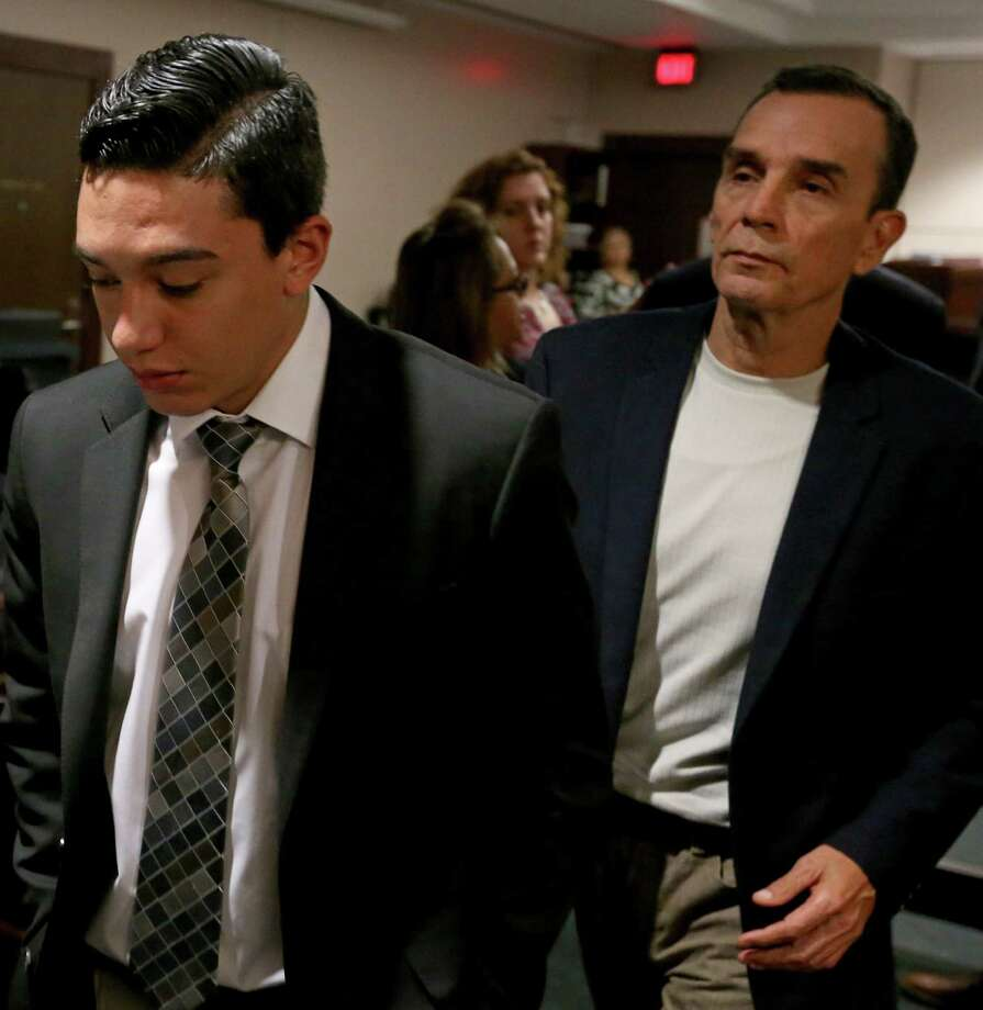 Defendant Antonio Flores, 22, (left) leaves the 226th District Court with his father Ricardo Flores Thursday May 19, 2016 after the jury was sequestered in the punishment phase of his manslaughter trial. Antonio Flores was convicted in the deaths of two Brandeis High School students Gabriella ÒGabbyÓ Lerma, 17, and Georgina ÒGinaÓ Rodriguez, 16, who were his back-seat passengers in a crash while street racing during their lunch break from the school in 2013. Photo: Edward A. Ornelas, Staff / San Antonio Express-News / © 2016 San Antonio Express-News