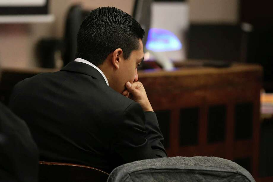 "Antonio Flores, 22, looks down during the punishment phase of his manslaughter trial in the Bexar County Criminal District 226th Court, Thursday, May 19, 2016. Flores was found guilty on two counts of manslaughter in the deaths of Gabriella ""Gabby"" Lerma, 17 and Georgina ""Gina"" Rodriguez, 16, in 2013. The two girls were passengers in a vehicle driven by Flores, who was racing at the time of the accident. The two girls were ejected. Flores is facing 20 years and is eligible for parole. Photo: JERRY LARA, Staff / San Antonio Express-News / © 2016 San Antonio Express-News"