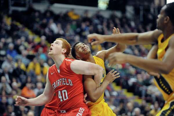 Kevin Degnan of Fairfield, left, and Lavon Long of Siena battle for position under the basket and during their game at the Times Union Center on Sunday, Jan. 11, 2015, in Albany, N.Y.   (Paul Buckowski / Times Union)