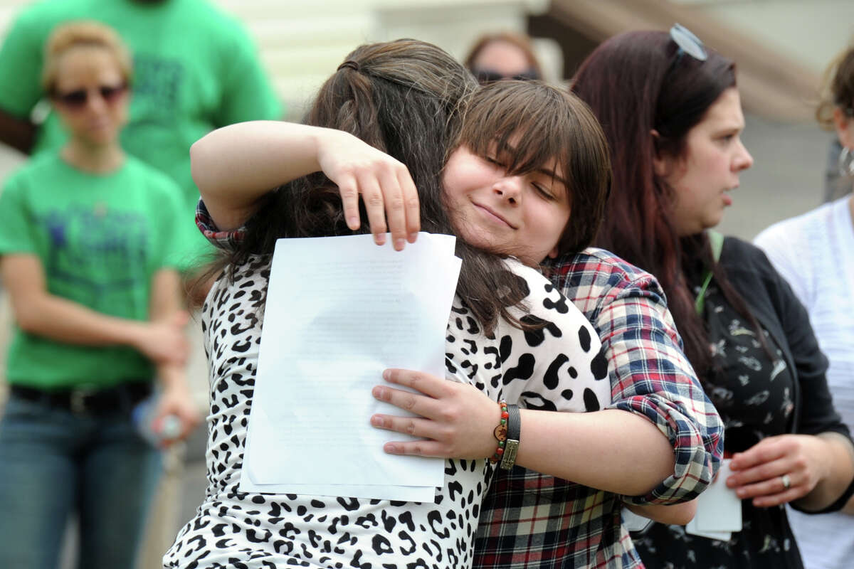 Theresa Torony hugs her mother, Alicia Buechner, after giving a speech during a groundbreaking ceremony held for the new Program and Services building at Boys & Girls Village, in Milford, Conn. May 18, 2016. Theresa received foster care coordinated through Boys & Girls Village.