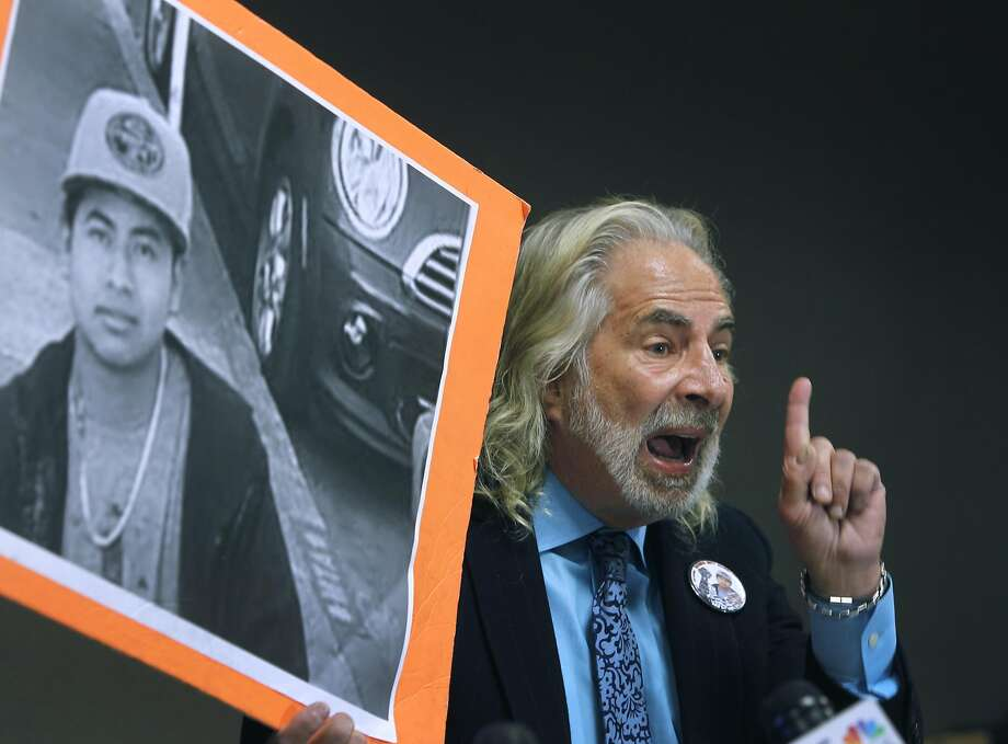 Attorney Jonathan Melrod holds up a photo of Amilcar Perez Lopez at a new conference in San Francisco, Calif. on Friday, April 24, 2015 to announce a federal lawsuit filed against the police department and Chief Greg Suhr. Attorneys allege that police officers killed Lopez on Feb. 26 while he was running from police, disputing the department's version that Lopez had lunged at officers with a knife. Photo: Paul Chinn, The Chronicle