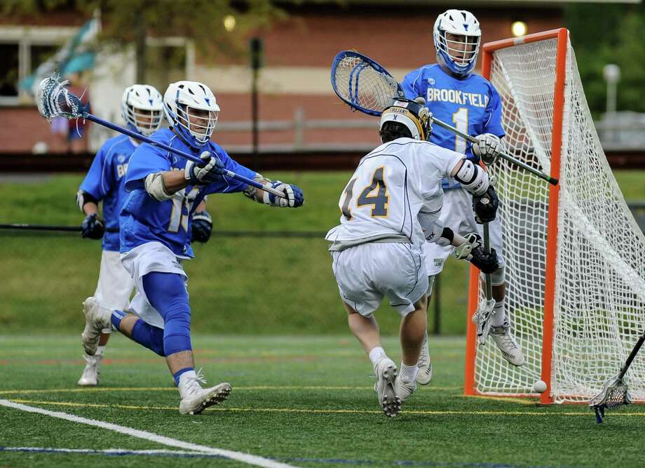 Alec Steinberg (14) of the Weston Trojans shot hits the post during a game against the Brookfield Bobcats at Weston High School on May 19, 2016 in Weston, Connecticut. Photo: Gregory Vasil / For Hearst Connecticut Media / Connecticut Post Freelance