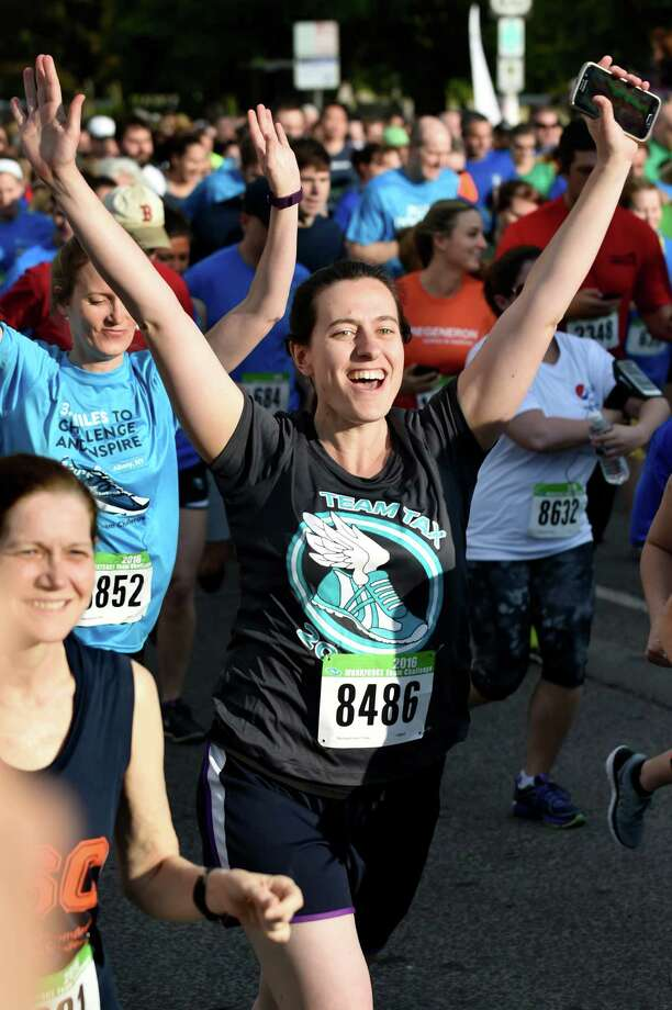 A runner with Team Tax starts out with high spirits during the CDPHP Workforce Team Challenge on Thursday, May 19, 2016, in Albany, N.Y. (Cindy Schultz / Times Union) Photo: Cindy Schultz / Albany Times Union