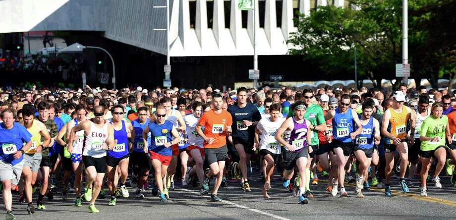 Runners start up Madison Avenue during the CDPHP Workforce Team Challenge on Thursday, May 19, 2016, in Albany, N.Y. (Cindy Schultz / Times Union) Photo: Cindy Schultz / Albany Times Union