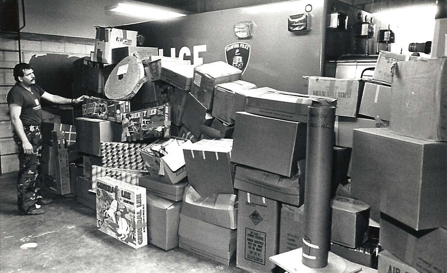 Stamford police seized dozens of cases of fireworks with an estimated value of $100,000 from 332 Washington Boulevard on June 29, 1986. The fireworks cache filled a garage bay at the police station at 805 Bedford St. Photo: Tom Ryan
