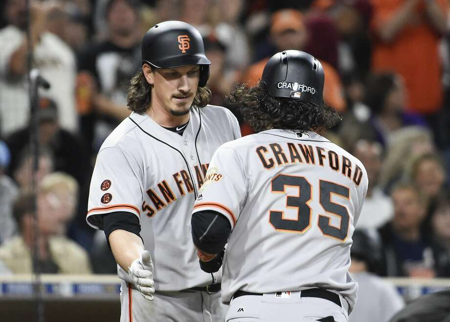 Brandon Crawford #35 of the San Francisco Giants is congratulated by Jeff Samardzija #29 after he hit a solo home run during the seventh inning of a baseball game against the San Diego Padres at PETCO Park on May 19, 2016 in San Diego, California.  Photo: Denis Poroy, Getty Images