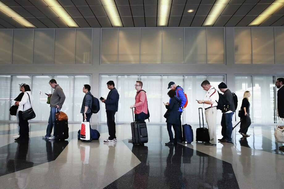 Passengers at Chicago's O'Hare International Airport wait to be screened earlier this week. Airlines say that with the summer bearing down, the TSA is understaffed. Photo: Scott Olson, Staff / 2016 Getty Images