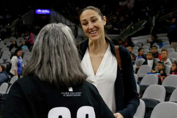 San Antonio Stars general manager Ruth Riley greets season ticket holder Gloria Drash before the game with Connecticut Sun at the AT&T Center on May 18, 2016.