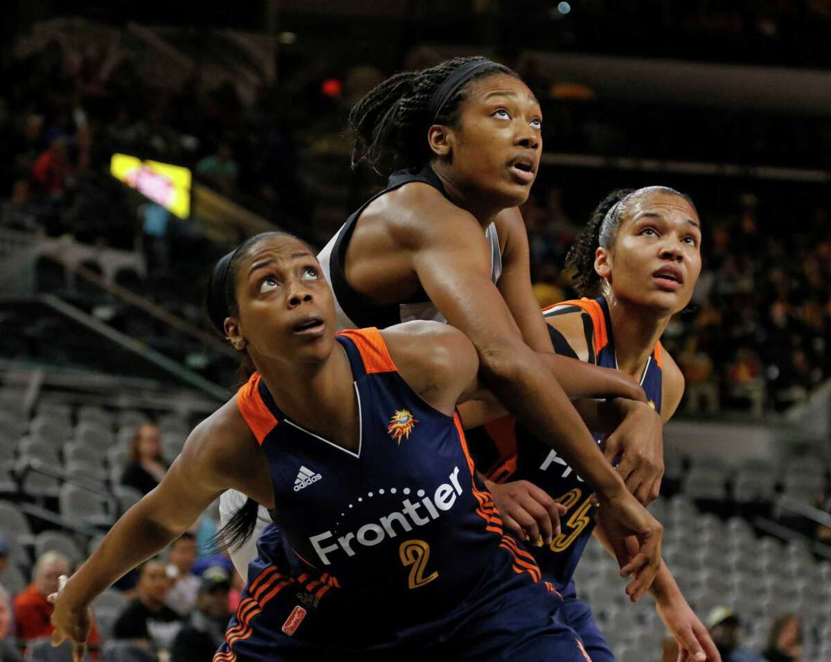 Connecticut's Camille Little (left) and Connecticut Alyssa Thomas (right) block out the San Antonio Stars' Kayla Alexander at the AT&T Center on May 19, 2016.