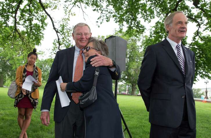 Sen. Barbara Boxer, D-Calif., embraces Sen. James Inhofe, R-Okla., on Thursday in Washington during a news conference to discuss bipartisan legislation to improve the federal regulation of chemicals and toxic substances.