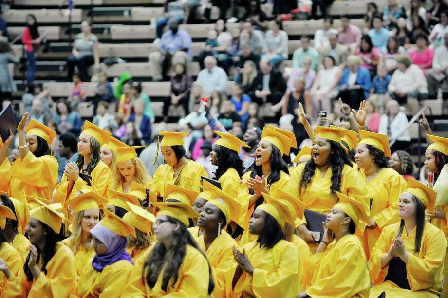 Graduates cheer on their fellow graduates at the Troy High School graduation at Hudson Valley Community College, on Sunday, June 28, 2015, in Troy, N.Y.  (Paul Buckowski / Times Union) Photo: PAUL BUCKOWSKI / 00032185A