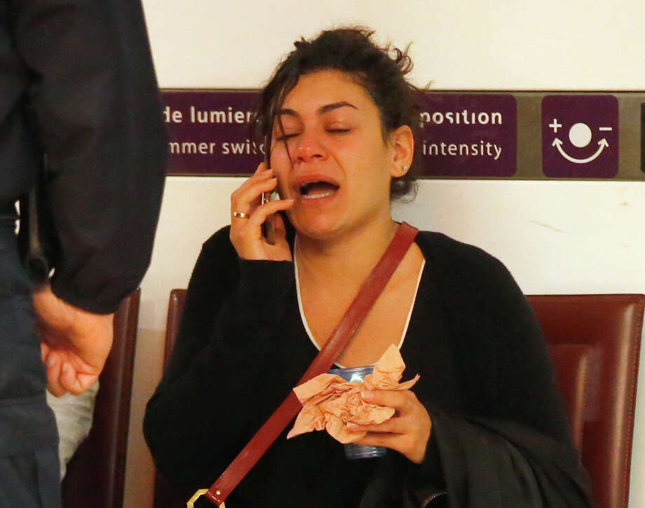 A relative of the victims of the EgyptAir flight 804 reacts as she makes a phone call at Charles de Gaulle Airport outside of Paris, Thursday, May 19, 2016. Egyptian aviation officials say an EgyptAir flight from Paris to Cairo with 66 passengers and crew on board has crashed. (AP Photo/Michel Euler) ORG XMIT: REB106 Photo: Michel Euler / AP