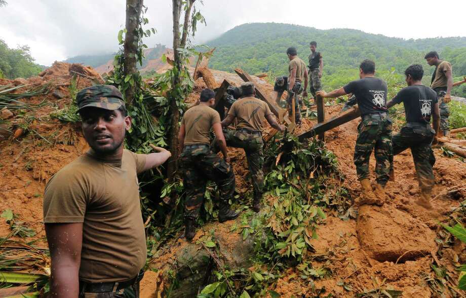 Sri Lankan army soldiers carry out a search operation in Elangapitiya village in Aranayaka, some 72 kilometers (45 miles) north of Colombo, Sri Lanka, Thursday, May 19, 2016. Heavy rains Thursday continued to pound the central Sri Lankan region where at least three villages have already been swallowed by mountains of mud, forcing army soldiers and police to suspend rescue work. (AP Photo/Eranga Jayawardena) ORG XMIT: DEL110 Photo: Eranga Jayawardena / Copyright 2016 The Associated Press. All rights reserved. This m