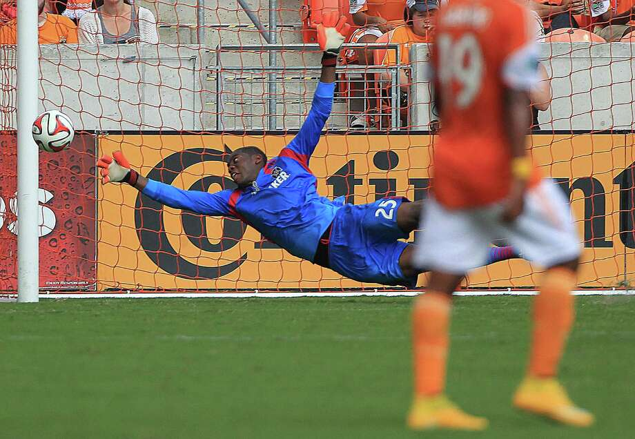 Chicago goalie Sean Johnson, deflecting a Dynamo shot in an earlier game, has been playing well. Photo: James Nielsen, Staff / © 2014  Houston Chronicle