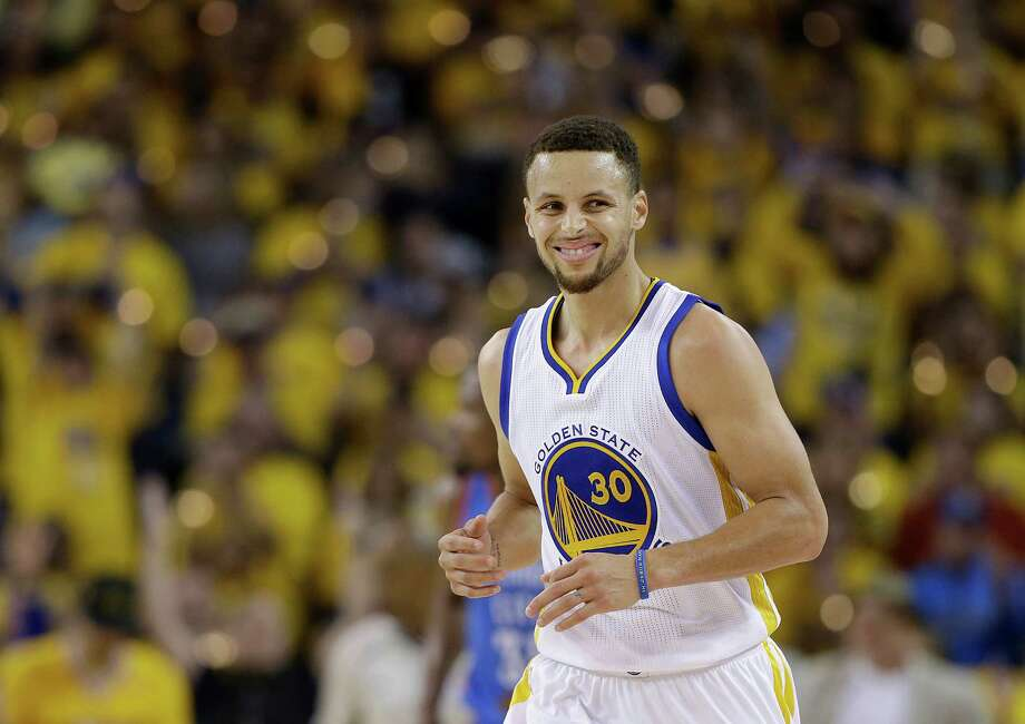 Golden State Warriors guard Stephen Curry (30) reacts after making a 3-point basket against the Oklahoma City Thunder during the first half of Game 1 of the NBA basketball Western Conference finals in Oakland, Calif., Monday, May 16, 2016. (AP Photo/Marcio Jose Sanchez) Photo: Marcio Jose Sanchez, STF / AP