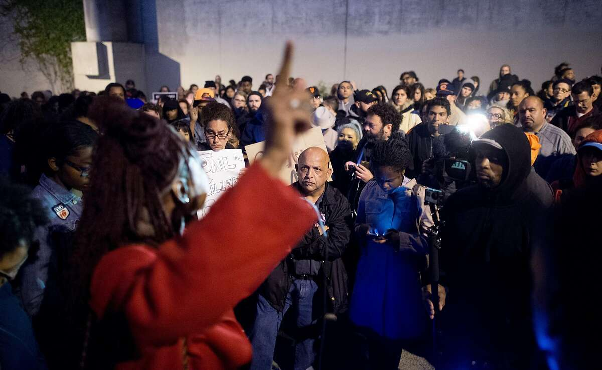 More than a hundred people gather during a vigil for a 27-year-old woman shot and killed by a San Francisco police sergeant earlier in the day on Thursday, May 19, 2016, in San Francisco.
