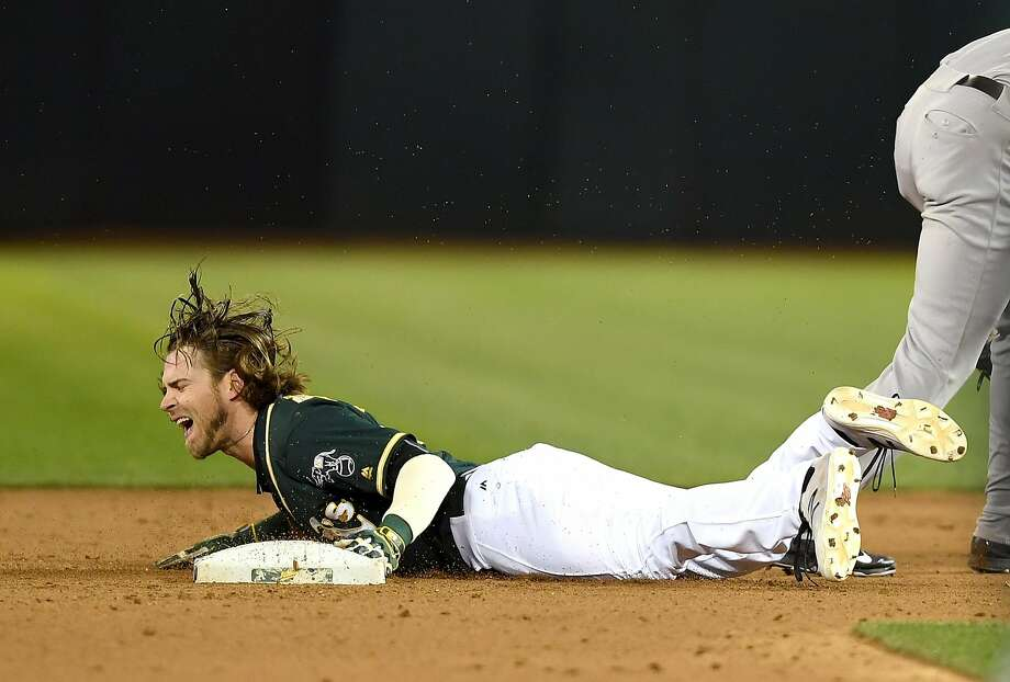 Josh Reddick howls in pain as he steals second, a play that resulted in him breaking his left thumb. Photo: Thearon W. Henderson, Getty Images