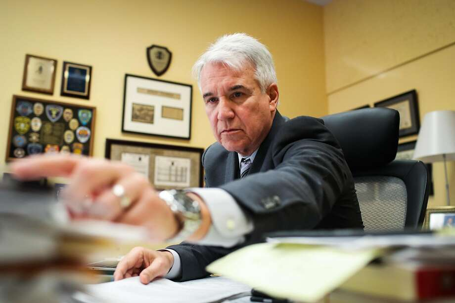 District Attorney George Gascon grabs paperwork while working in his office at the Hall of Justice, in San Francisco, California, on Wednesday, May 18, 2016. District Attorney George Gascón joined representatives from the Police Department, the Human Rights Commission and the mayor's office at a news conference to say bigotry in any form would not be tolerated in the city. Photo: Gabrielle Lurie, Special To The Chronicle